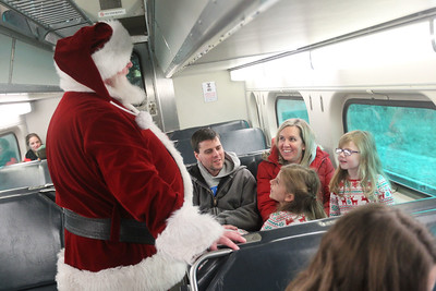 Candace H. Johnson-For Shaw Media Brad and Stacy Kaminscky, of Spring Grove and their children, Katrina, 6, and Caroline, 5, visit with Santa on the train back from the North Pole to Antioch during the North Pole Express. The Village of Antioch Parks & Recreation hosted the event. (12/16/19)