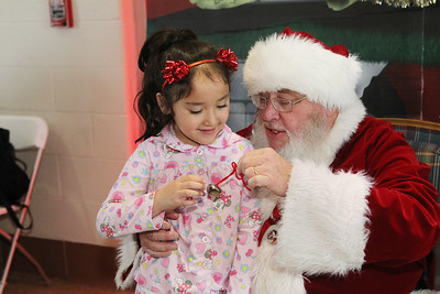 Candace H. Johnson-For Shaw Media Nicole Lagunas, 5, of Antioch gets a bell from Santa on the North Pole after taking the North Pole Express from Antioch. The Village of Antioch Parks & Recreation hosted the North Pole Express event. (12/16/19)