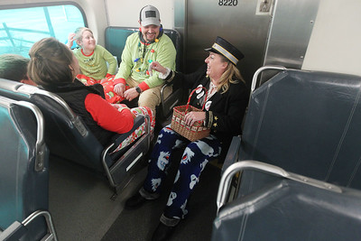 Candace H. Johnson-For Shaw Media Sandra Simon, of Antioch (as the Conductor) shares a laugh with the Morales family, of Antioch on the North Pole Express from the North Pole to Antioch as she hands them reindeer food. The Village of Antioch Parks & Recreation sponsored the event. (12/16/19)