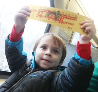 Candace H. Johnson-For Shaw Media Isaac Rolakowski, 3, of Gurnee holds up his Golden Ticket as he rides the North Pole Express from Antioch to the North Pole. The Village of Antioch Parks & Recreation hosted the North Pole Express event. (12/16/19)