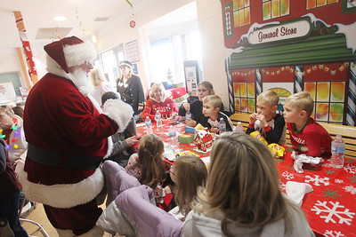 Candace H. Johnson-For Shaw Media Santa greets a table of visitors at the North Pole after they took the North Pole Express from Antioch. The Village of Antioch Parks & Recreation hosted the event. (12/16/19)