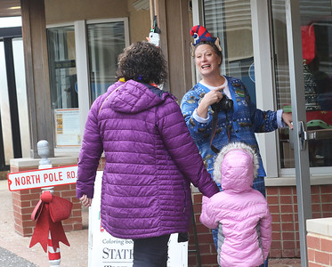 Candace H. Johnson-For Shaw Media Toni Galster, special event coordinator, greets visitors as they arrive at the North Pole after taking the train from Antioch during the North Pole Express. The Village of Antioch Parks & Recreation sponsored the event. (12/16/19)