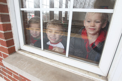 Candace H. Johnson-For Shaw Media Erik Sullivan, 5, of Antioch and his brothers, James, 5, and Jaxon, 6, look out the window of the Antioch Metra Station waiting for the train to take them to the North Pole during the North Pole Express in Antioch. The Village of Antioch Parks & Recreation hosted the event. (12/16/19)