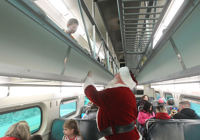 Candace H. Johnson-For Shaw Media Brenden Fries, 7, of Ingleside talks to Santa on the way back to Antioch from the North Pole on the North Pole Express. The Village of Antioch Parks & Recreation hosted the event. (12/16/19)