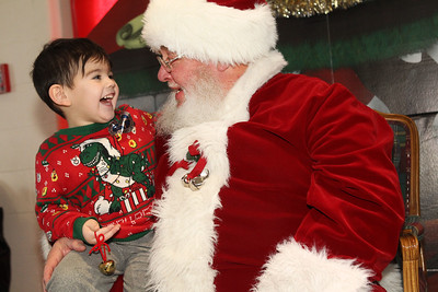 Candace H. Johnson-For Shaw Media Declan Shearer, 3, of North Chicago shares a laugh with Santa while he visits him on the North Pole during the North Pole Express from Antioch. The Village of Antioch Parks & Recreation hosted the event. (12/16/19)