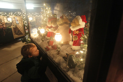 "Candace H. Johnson-For Shaw Media Maxwell McClure, 4, of Zion looks at a supersized shadowbox titled, ""Caroling, Caroling through the Snow,"" in the indoor showroom of Kringle's Christmas Village at #510 Orchard Street in downtown Antioch. The Village is open daily from 10:00am until 8:00 pm through January 1st, 2020. (12/21/19)"
