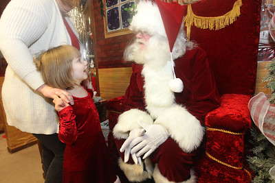 Candace H. Johnson-For Shaw Media Renee LaBarbera, 4, of Wadsworth stands next to her mother, Marianne, as she visits with Santa at Santa's Frozen Village at 882 Main Street in downtown Antioch. Santa's Village was sponsored by the Antioch Chamber of Commerce. (12/21/19)