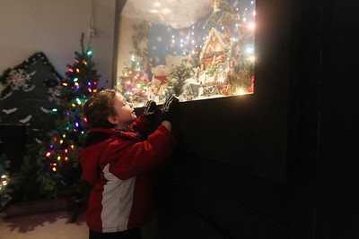 Candace H. Johnson-For Shaw Media Mitchell McCllure, 5, of Zion looks what's inside a supersized shadowbox in the indoor showroom for Kringle's Christmas Village at #510 Orchard Street in downtown Antioch. The Village is open daily from 10:00 am until 8:00 pm through January 1st, 2020. (12/21/19)