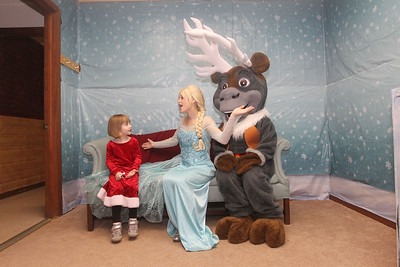 Candace H. Johnson-For Shaw Media Renee LaBarbera, 4, of Wadsworth sings with Queen Elsa (Jessica Lamberty, 20, of Antioch) and Sven (Madison Novack, 18, of Lake Villa) at Santa's Frozen Village at 882 Main Street in downtown Antioch. Santa's Village was sponsored by the Antioch Chamber of Commerce. (12/21/19)