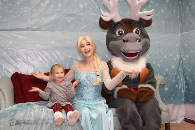 Candace H. Johnson-For Shaw Media Lola Ohren, 3, of Lakemoor gets her photo taken with Queen Elsa (Jessica Lamberty, 20, of Antioch) and Sven (Madison Novack, 18, of Lake Villa) at Santa's Frozen Village at 882 Main Street in downtown Antioch. Santa's Village was sponsored by the Antioch Chamber of Commerce. (12/21/19)