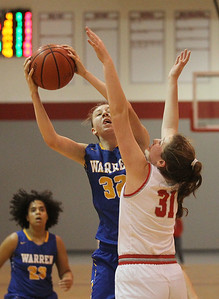 Candace H. Johnson-For Shaw Media Warren's Grace Lynch goes up for a shot against Deerfield's Olivia Kerndt in the fourth quarter during the Grant Girls Basketball Varsity Holiday Tournament in Fox Lake. Deerfield won 54-47 (OT).  (12/21/19)
