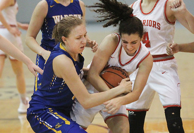 Candace H. Johnson-For Shaw Media Warren's Grace Lynch fights for a rebound with Deerfield's Lexi Kerstein in overtime during the Grant Girls Basketball Varsity Holiday Tournament in Fox Lake. Deerfield won 54-47 (OT).  (12/21/19)