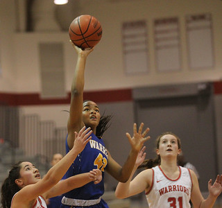 Candace H. Johnson-For Shaw Media Warren's Zion Levy leaps up for a shot against Deerfield's Alex Tiatia and Olivia Kerndt in the fourth quarter during the Grant Girls Basketball Varsity Holiday Tournament in Fox Lake. Deerfield won 54-47 (OT).  (12/21/19)