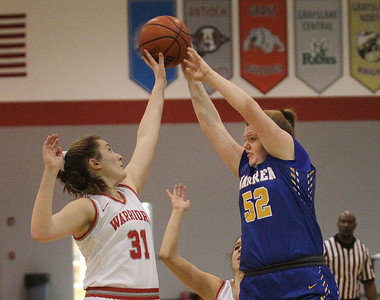 Candace H. Johnson-For Shaw Media Deerfield's Olivia Kerndt tries to block a pass by Warren's Annika Gustafson in the second quarter during the Grant Girls Basketball Varsity Holiday Tournament in Fox Lake. Deerfield won 54-47 (OT).  (12/21/19)
