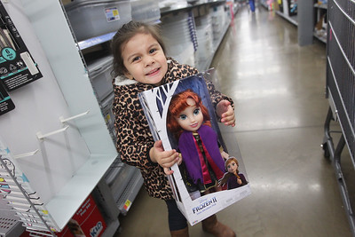 Candace H. Johnson-For Shaw Media Madison Garibay, 4, of Round Lake Beach is all smiles as she shows off a doll she picked out during Lake Villa's Shop with a Cop at Walmart in Round Lake Beach. (12/19/19)