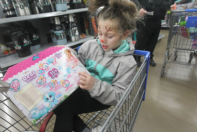 Candace H. Johnson-For Shaw Media Mariella Levas, 6, of Antioch talks about the Real Rescue Electronic Pet she picked out during Lake Villa's Shop with a Cop at Walmart in Round Lake Beach. (12/19/19)