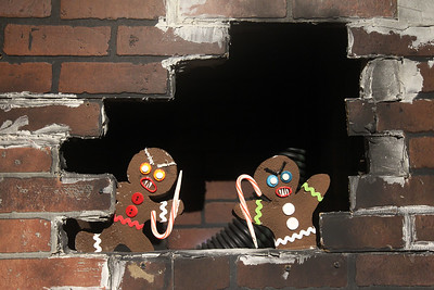 Candace H. Johnson-For Shaw Media Two Gingerbread men stick out of a wall in the Gingerbread Revenge scene at the X-Mas Haunting, an interactive Christmas experience in The Gallery at Hawthorn Mall in Vernon Hills. The Gallery is the former Carson Pirie Scott Furniture Gallery at 480 Ring Drive in Vernon Hills. The pop-up gallery is open until January 4th, 2020. (12/21/19)