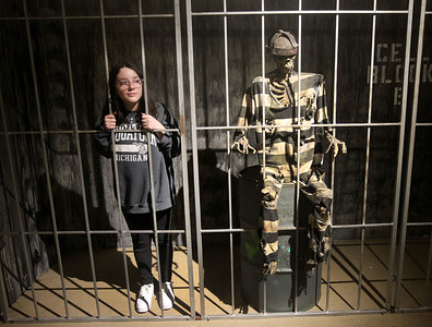 Candace H. Johnson-For Shaw Media Jasmine Tresenriter, 13, of Hainesville stands next to a skeleton in jail at the X-Mas Haunting, an interactive Christmas experience in The Gallery at Hawthorn Mall in Vernon Hills. The Gallery is the former Carson Pirie Scott Furniture Gallery at 480 Ring Drive in Vernon Hills. The pop-up gallery is open until January 4th, 2020. (12/21/19)