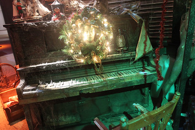 Candace H. Johnson-For Shaw Media A piano sits in the attic scene at the X-Mas Haunting, an interactive Christmas experience, in The Gallery at Hawthorn Mall in Vernon Hills. The Gallery is the former Carson Pirie Scott Furniture Gallery at 480 Ring Drive in Vernon Hills. The pop-up gallery is open until January 4th, 2020. (12/21/19)