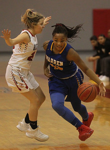 Candace H. Johnson-For Shaw Media Warren's Zion Levy (on right) drives around Grant's Nicolette Kouvelis in the first quarter during the Grant Girls Basketball Varsity Holiday Tournament at Grant Community High School in Fox Lake.  Grant won 67-66.   (12/27/19)