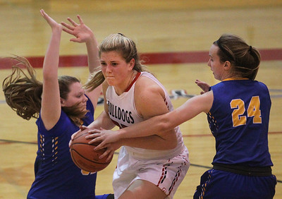 Candace H. Johnson-For Shaw Media Grant's Jazzlyn Linbo drives to the basket against Warren's Annika Gustafson and Caroline Sharpe in the fourth quarter during the Grant Girls Basketball Varsity Holiday Tournament at Grant Community High School in Fox Lake.  Grant won 67-66.   (12/27/19)