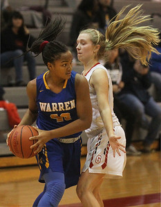 Candace H. Johnson-For Shaw Media Warren's Zion Levy looks to pass against Grant's Cora Hughs in the second quarter during the Grant Girls Basketball Varsity Holiday Tournament at Grant Community High School in Fox Lake.  Grant won 67-66.   (12/27/19)
