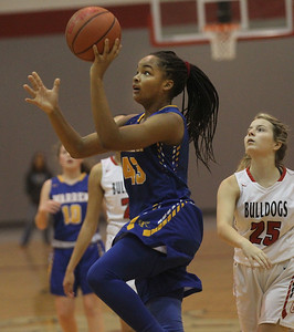 Candace H. Johnson-For Shaw Media Warren's Zion Levy aims for the hoop against Grant's Nicolette Kouvelis in the first quarter during the Grant Girls Basketball Varsity Holiday Tournament at Grant Community High School in Fox Lake.  Grant won 67-66.   (12/27/19)