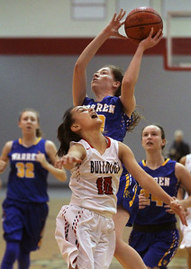 Candace H. Johnson-For Shaw Media Grant's MaCalyn Flores tries to block a shot by Warren's Macy Kocen in the second quarter during the Grant Girls Basketball Varsity Holiday Tournament at Grant Community High School in Fox Lake.  Grant won 67-66.   (12/27/19)