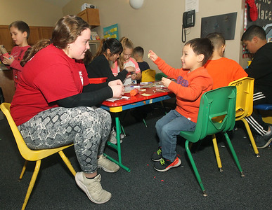 Candace H. Johnson-For Shaw Media Counselor Jane O'Connor helps Blake Canpeol, 5, both of Grayslake make a New Year's popper during Winter Camp with a New Year's Party theme at the Grayslake Community Park District's Recreational Center in Grayslake. (12/30/19)