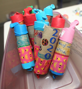 Candace H. Johnson-For Shaw Media New Year's poppers sit in a container made by children using paper towel rolls, balloons, duck tape, paper and stickers during Winter Camp with a New Year's Party theme at the Grayslake Community Park District's Recreational Center in Grayslake. (12/30/19)