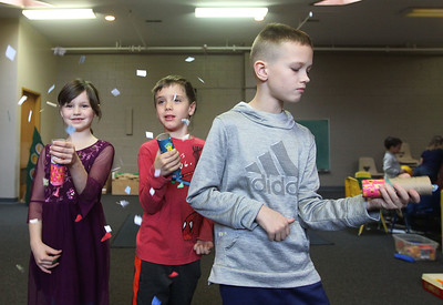 Candace H. Johnson-For Shaw Media Gabi Worth, 7, Asher Wing, 5, and Mark Lenczycki, 10, all of Grayslake test the New Year's poppers they made during Winter Camp with a New Year's Party theme at the Grayslake Community Park District's Recreational Center in Grayslake. (12/30/19)