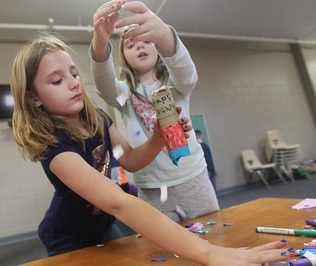 Candace H. Johnson-For Shaw Media Callie Hinze gets some help putting confetti into her New Year's popper from Shannon McGrouary, both 9, of Grayslake during Winter Camp with a New Year's Party theme at the Grayslake Community Park District's Recreational Center in Grayslake. (12/30/19)