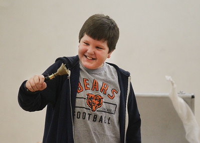 Candace H. Johnson-For Shaw Media Charlie Andre, 10, of Lindenhurst volunteers to help with a bell trick during the Winter Break Holiday Magic Show featuring the Magic of Gary Kantor at the Lindenhurst Park District Lippert Community Center. (12/27/19)