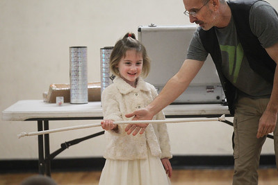 Candace H. Johnson-For Shaw Media Mara Wilson 4, of Lake Villa volunteers to help Magician Gary Kantor, of Skokie with a rope trick during the Winter Break Holiday Magic Show at the Lindenhurst Park District Lippert Community Center. (12/27/19)
