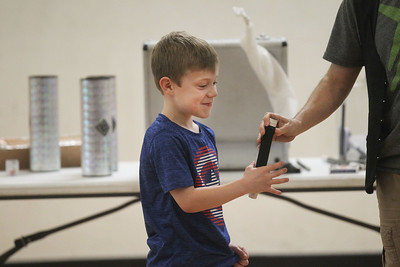 Candace H. Johnson-For Shaw Media Griffin Mertin, 6, of Lindenhurst helps Magician Gary Kantor with one of his magic tricks during the Winter Break Holiday Magic Show at the Lindenhurst Park District Lippert Community Center. (12/27/19)