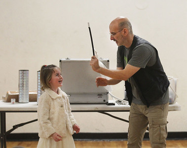 Candace H. Johnson-For Shaw Media Mara Wilson, 4, of Lake Villa helps Magician Gary Kantor with a magic trick during the Winter Break Holiday Magic Show at the Lindenhurst Park District Lippert Community Center. (12/27/19)