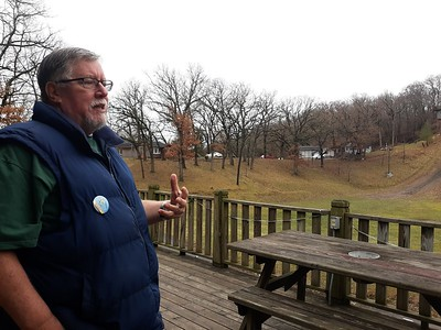 "Charlie Sedevic, publicity chairman for the Norge Ski Club in Fox River Grove, explains Sunday how the club still has tournaments without snow on the ground. ""We're going to have a tournament, [bu]) whether it's going to be on plastic or snow, that will be the big question,"" he said."