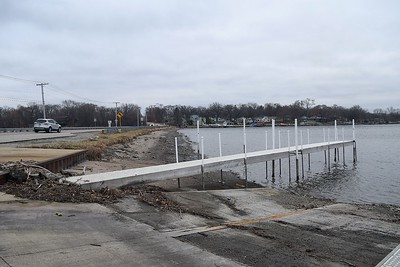 The Fox River, seen Monday with North River Road intersecting the Fox River in McHenry, is not expected to rise to levels that would threaten a flood after rains soaked the area Sunday night into Monday morning.