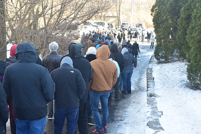 Hundreds of people line up outside Verilife Marijuana Dispensary in North Aurora on Jan. 1st to purchase legal marijuana.