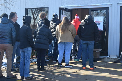 People who have been waiting in line for hours Wednesday enter the Verilife Marijuana Dispensary located on South Lincolnway in North Aurora to buy marijuana.
