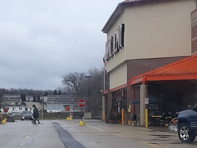 People walk into a Home Depot in Crystal Lake on Sunday.