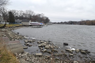 The Fox River, seen Monday near North River Road in McHenry, is not expected to rise to levels that would threaten a flood after rains soaked the area Sunday night into Monday morning.
