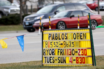 Cars drive by Pablo's Family Fiesta on Tuesday, Dec. 22, 2020 in Crystal Lake.
