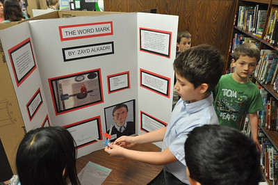 Sarah Minor — sminor@shawmedia.com Zayd Alkadri of Elm School demonstrates his invention, The Word Mark, during an invention convention on Tuesday, May 7.