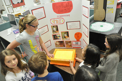 Sarah Minor — sminor@shawmedia.com Elm School's Caroline Kotarski shows fellow students her invention, the Portable Desk, on Tuesday, May 7.