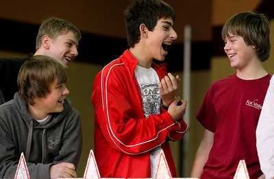 Lauren M. Anderson - landerson@shawmedia.com Max Ribarczyk (from left) Joey Wightman, Cullen Bennett and Richie vonHelms react after correctly answering a question on Wednesday during The Great American Challenge at St. John the Baptist Catholic School in Johnsburg.