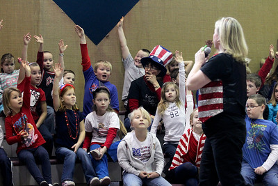 Lauren M. Anderson - landerson@shawmedia.com Students at St. John the Baptist Catholic School in Johnsburg raise their hands during The Great American Challenge event on Wednesday. Students were asked questions about American history, geography and Catholicism.