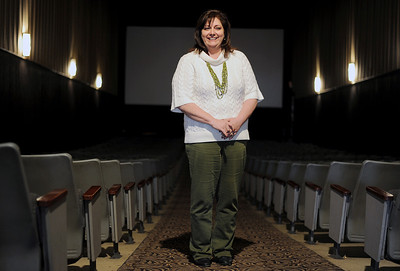 """Sarah Nader - snader@shawmedia.com Cindy Kottke, owner of """"C"""" You At The Movies, a company that operates two movie theaters, one of which is located in downtown McHenry takes a portrait in one of the screening rooms at the McHenry location on Wednesday, February 1, 2012."""
