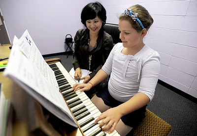 Sarah Nader - snader@shawmedia.com Kailey Krigas, 9, of Fox River Grove takes a piano lesson with Erin Yu  at the Cary Grove Performing Arts Center in Cary on Wednesday, February 1, 2012. Krigas has been taking piano lessons for almost four years.