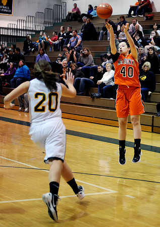 Sarah Nader - snader@shawmedia.com McHenry's Michelle Kelly (right) makes a shot during the fourth quarter of Wednesday's game against Crystal Lake on February 1, 2012. McHenry won, 50-41.